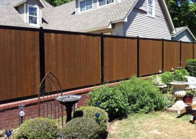Privacy Fence on Brick Wall