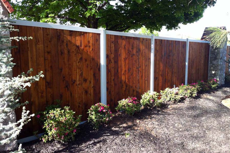 Stained Wood Fence With Metal Posts