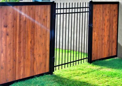 Wood Fence With Iron Gate