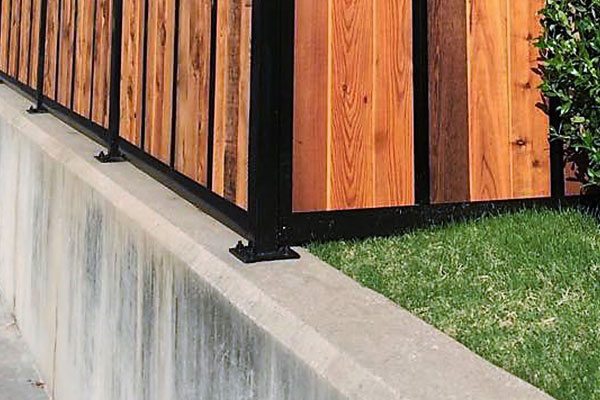 Fence Post Bolted to Retaining Wall