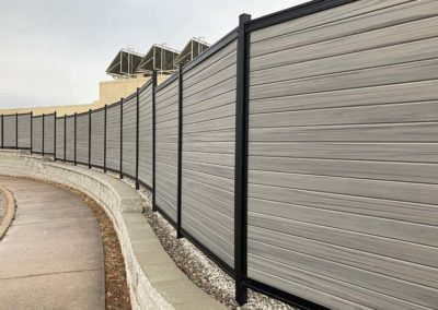 Fence Mounted to Retaining Wall
